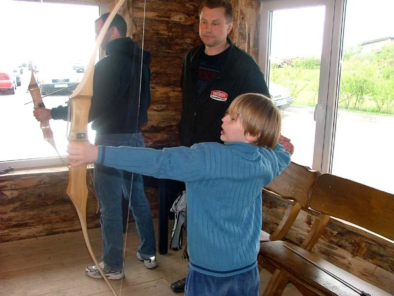 S and my nephew J practice archery