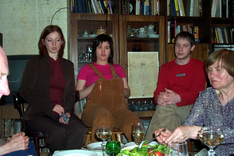 Left to right: my sister M, her friend L, M's then-boyfriend-now-husband P, and my brother's mother-in-law N, in the living room of my parents' home in May of 2004.