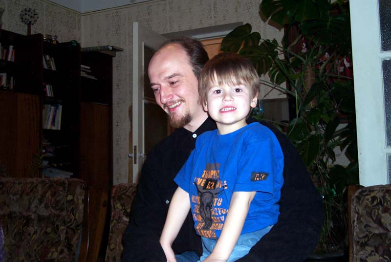 My brother J with his 5-year-old son D at my parents' home in May of 2004