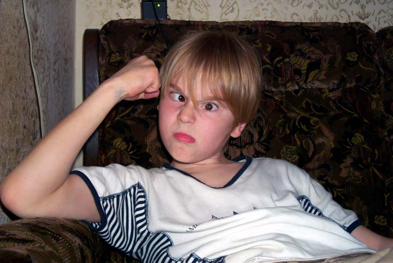 My nephew J strikes his most menacing pose. (May 2004)