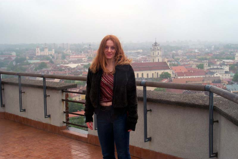 Me on the observation deck at the top of the Vilnius castle, with some of the Vilnius Old Town visible behind me (May 2004)