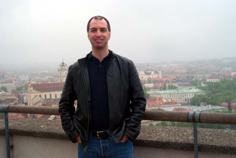 S on the observation deck at the top of the Vilnius castle, with some of the Vilnius Old Town visible behind him (May 2004)
