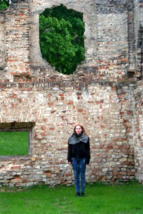 Me in front of a wall of an old decayed building on Sv. Kazimiero / St. Casimir's street in Vilnius Old Town