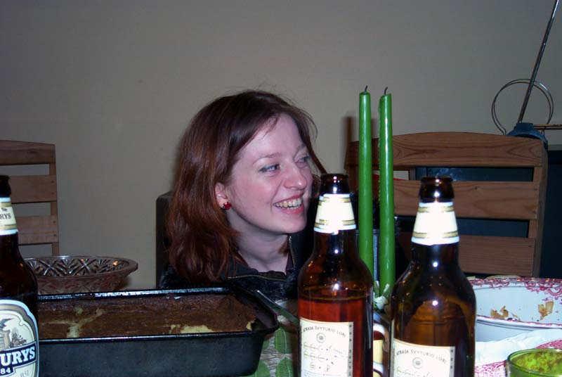 My sister M and an awesome potato pie (in the baking pan in front of her), made by my brother's mother-in-law. (May 2004)