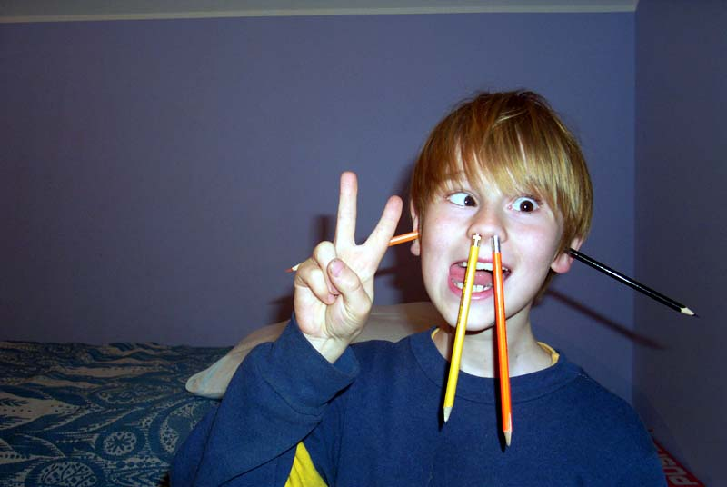 My brother's son J found a good way to keep pencils handy and prevent them from getting lost. (May 2004)