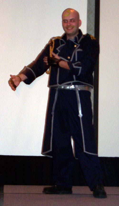 A guy named (nicknamed?) Proz in some kind of quasi military uniform-based costume at Linucon 2004