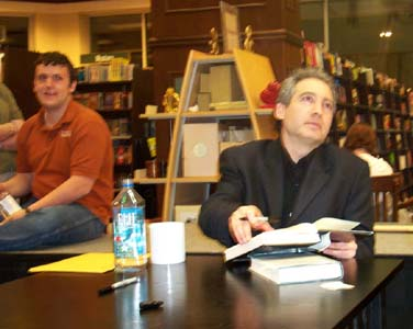 "Brian Greene signing the copies of his latest book, ""The Fabric of Cosmos"", at Barnes & Noble in Austin, TX in March of 2005"