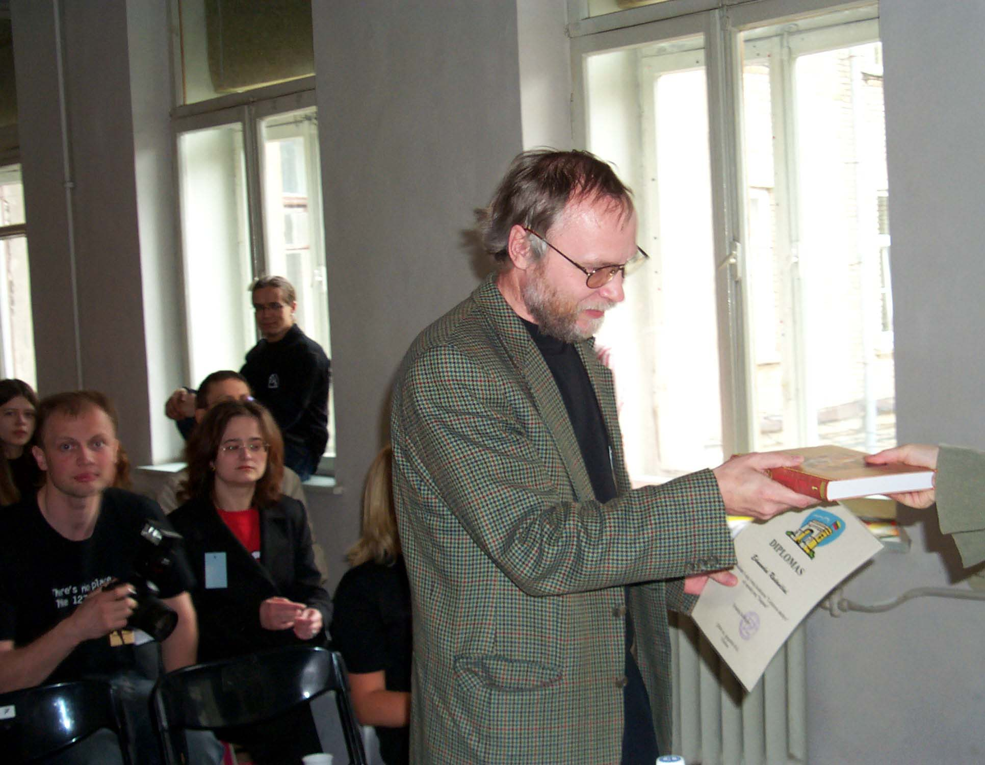 """Zumis receives his award as the winner of the short story contest """"The Futures of Lithuania"""" at the Lituanicon 2004, a science fiction convention in Vilnius, Lithuania, May 2004"""