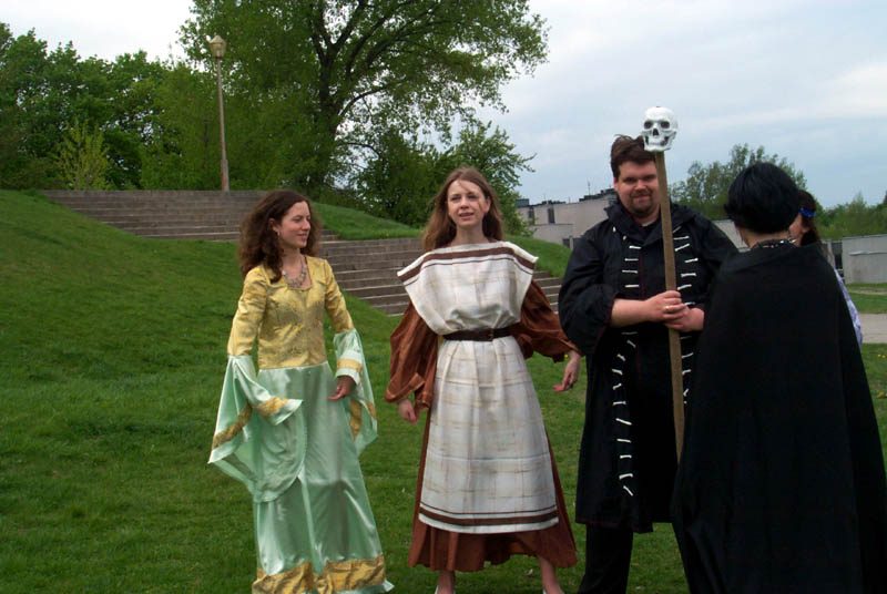Women in medieval-style dresses and a man dressed as a wizard at a LARPG played at the Lituanicon 2004, a science fiction convention in Vilnius, Lithuania, May 2004