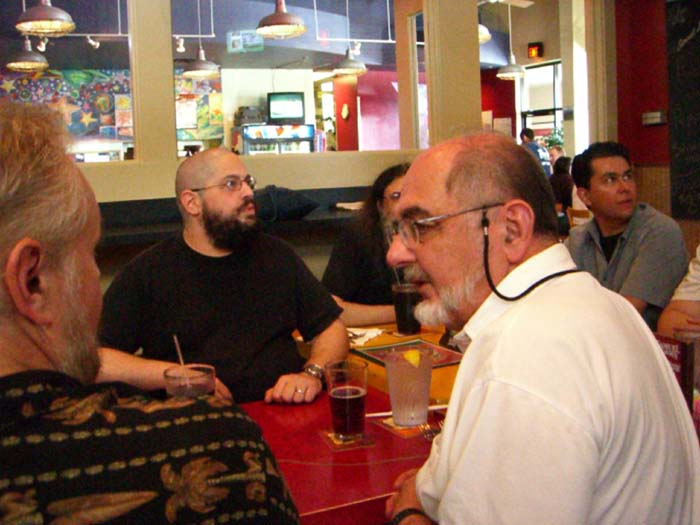 Charles Stross (second row) at the pizza lunch at the pizza lunch at ArmadilloCon 2005 in Austin, Texas