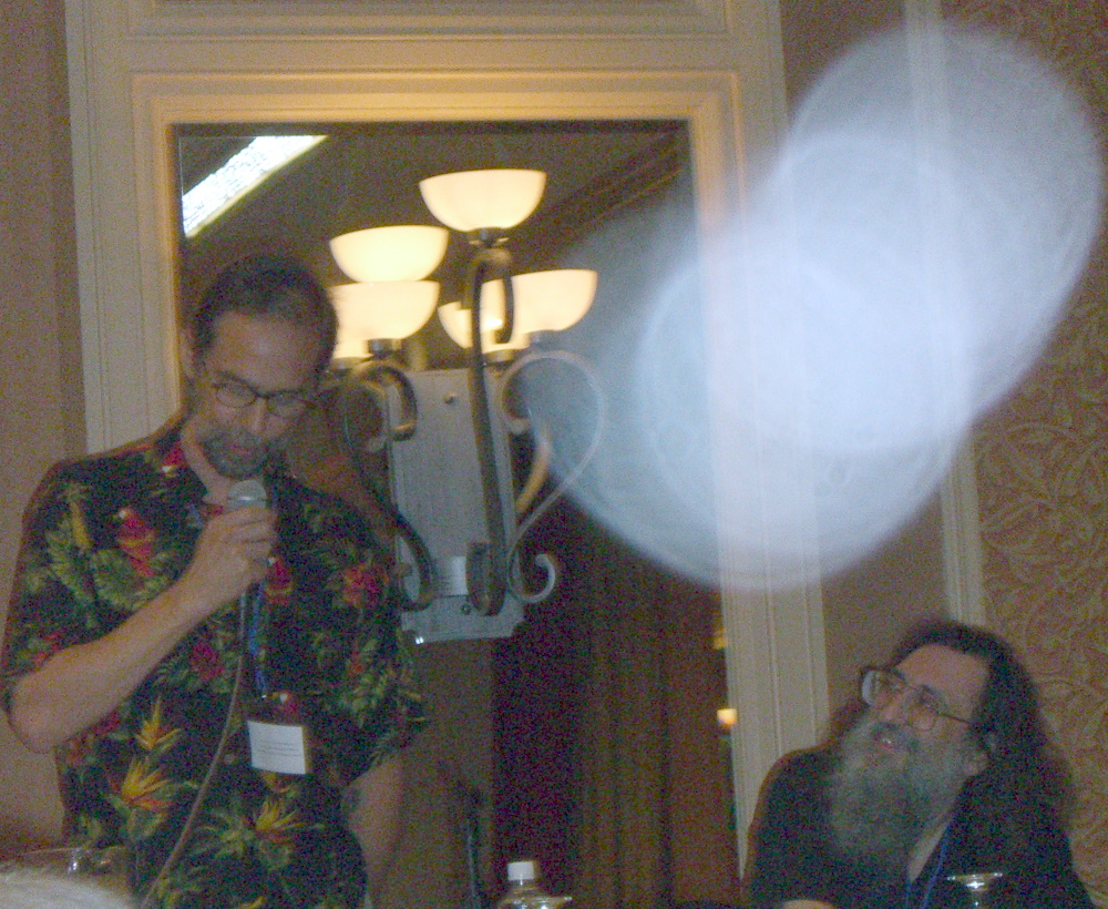 Author Charles de Lint (left) as the toastmaster at ArmadilloCon 2005, and artist guest of honor Ctein (right)