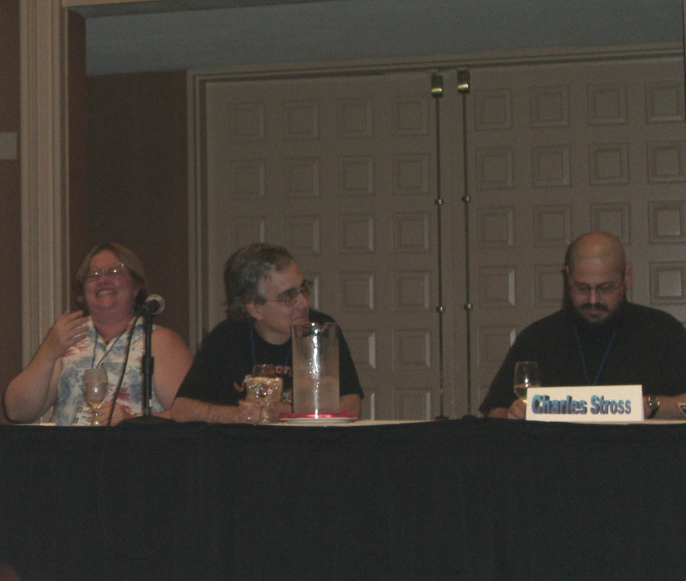 Laurie and Jim Mann and Charles Stross (right) at the ArmadilloCon 2005 opening ceremony, Austin, TX 2005
