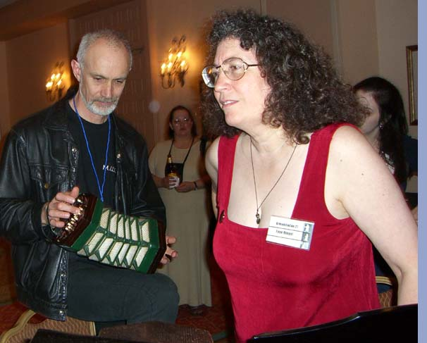 Sean Mcmullen with a concertina, and Faye Ringel at the ArmadilloCon 2005 in Austin, Texas