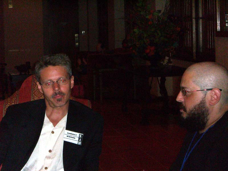 Charles Stross and Wil McCarthy at the ArmadilloCon 2005 praise each other's work