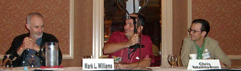 "Sean McMullen, Mark L. Williams and Chris Brown at the ""When and How Will the 21st Century Get More Interesting?"" panel at the ArmadilloCon 2005, Austin, TX, 2005"