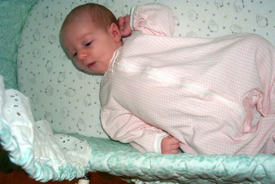 Fourth week: E in the bassinet where she slept in her early days
