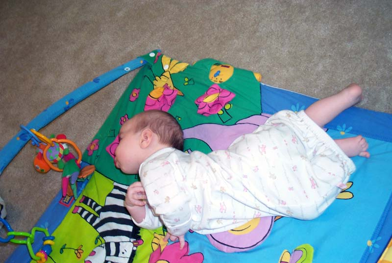 Ten weeks: tried to roll over and got stuck.