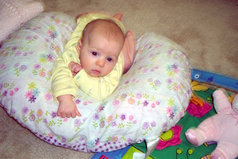 Three months: E on a Boppy pillow