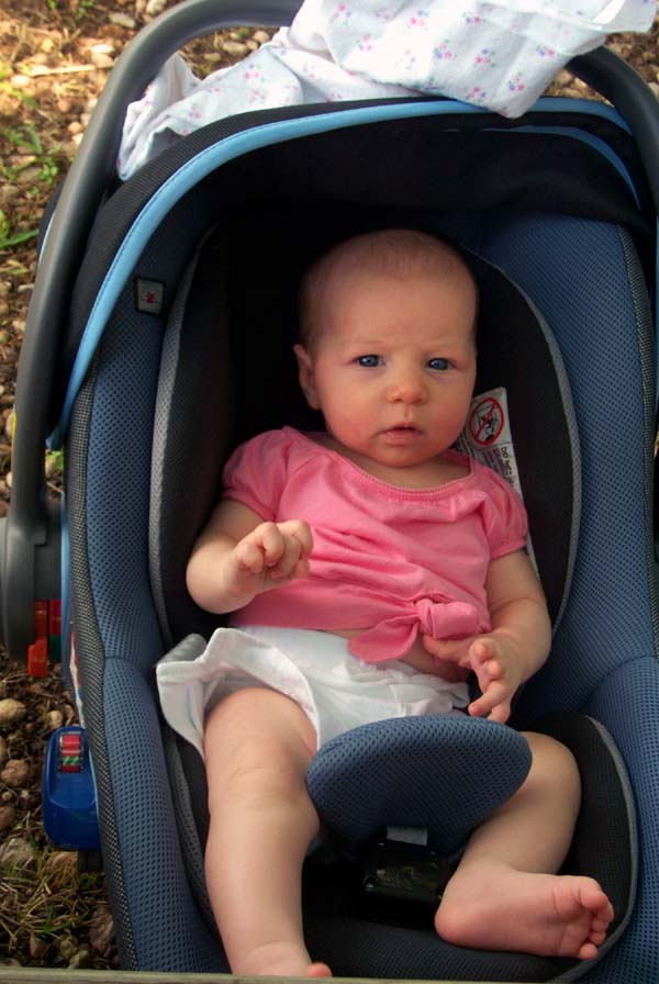 Eight weeks old, in the car seat at my work party