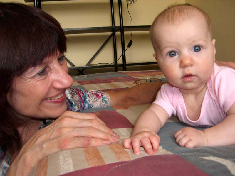 E's grandma (my mom) is enthralled by the baby. August 2005.