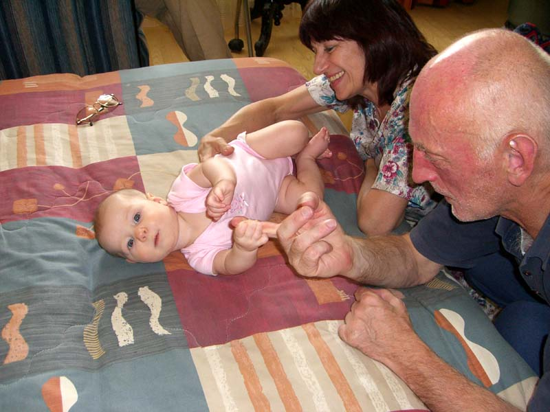 E's geographically remote grandparents (my parents) meet her for the first time. August 2005.