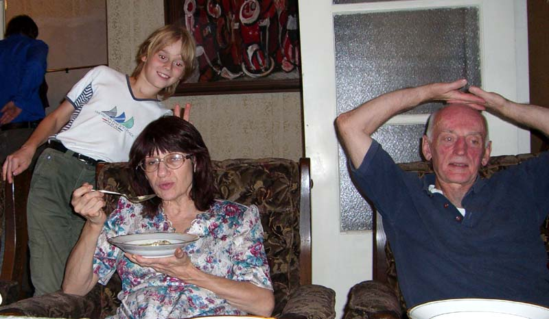 My mom, dad and my brother's son J at my parents' home. August 2005