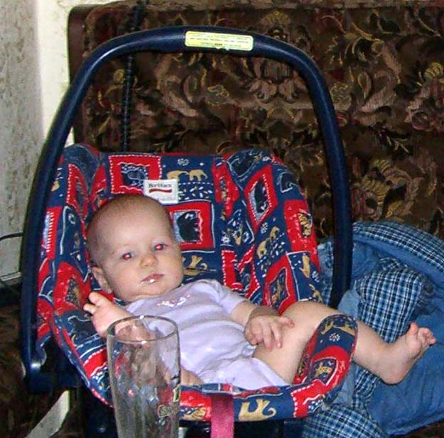 E is making a victory sign with her toes. August 2005.