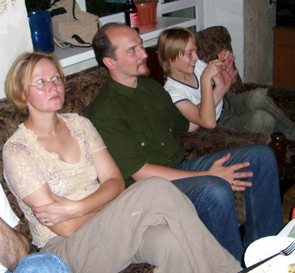My brother J, his wife E and their son J at my parents' home. August 2005.