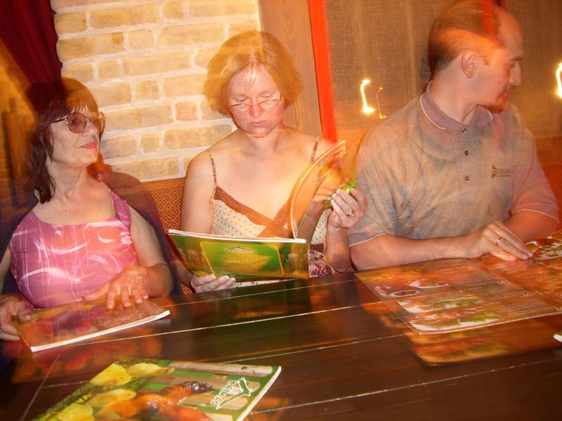 "CIMG0303 My mom, my sister-in-law E, and my brother J at the Chili Kaimas / ""Chili Village"" restaurant in Vilnius, August 2005"