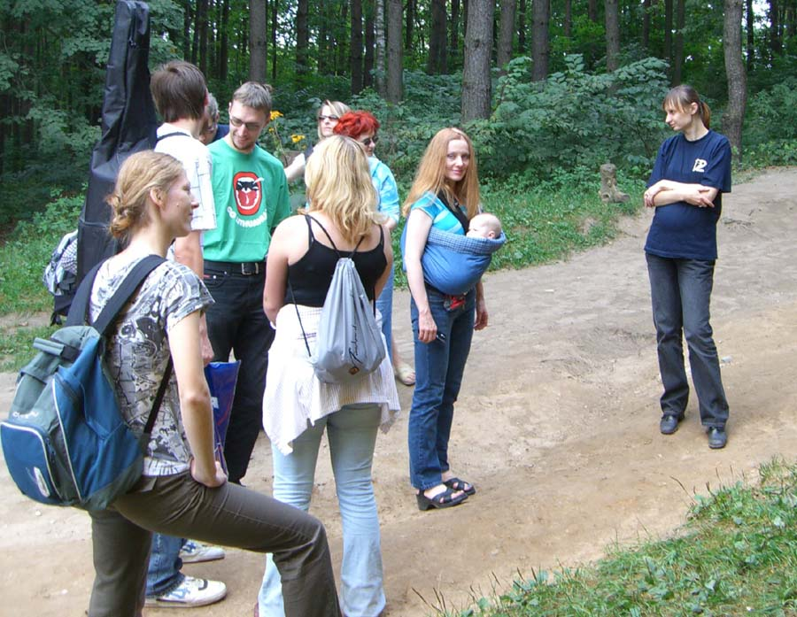 Me (with baby E in a sling) at the Lithuanian science fiction fandom picnic in September of 2005
