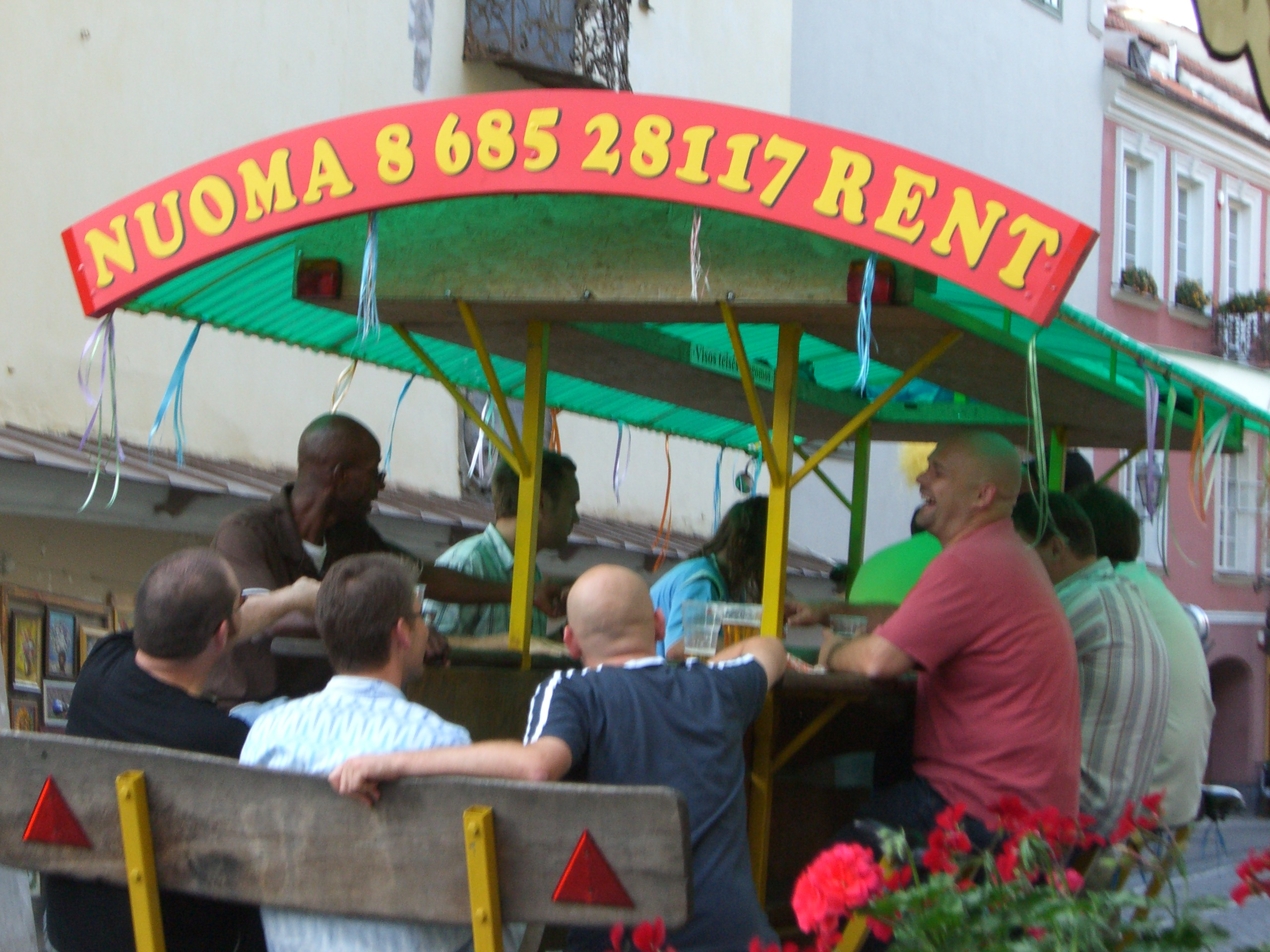 A bar on wheels drives down the street in Vilnius Old Town in September 2005