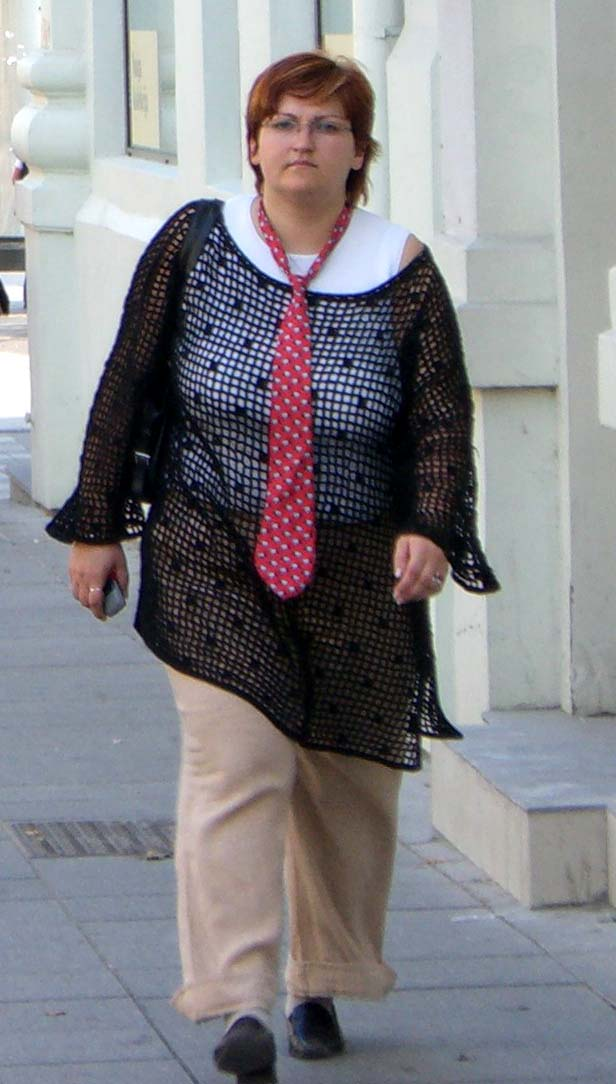 A long black crocheted tunic with a red tie, September 2005, Vilnius, Lithuania