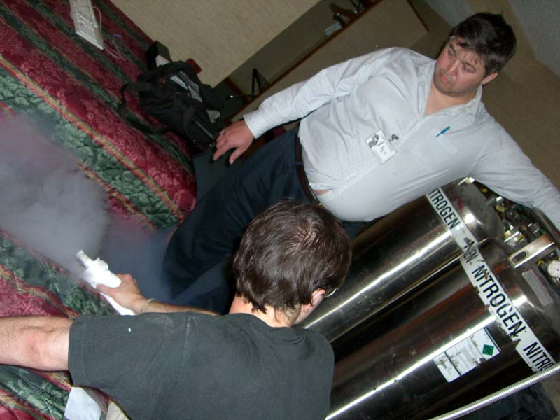 Rob Landley and Big O are testing a can of liquid nitrogen at Linucon 2005