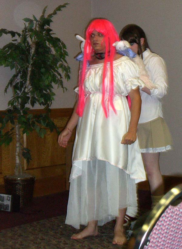 A guy in a pink wig and angel wings at Linucon 2005 cosplay