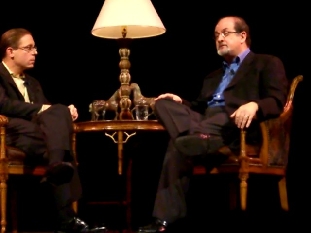 Evan Smith (left) interviewing Salman Rushdie at the Texas Book Festival in 2005