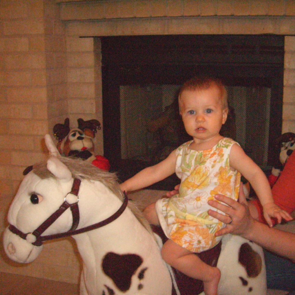8-month-old E on a rocking horse, January 2006