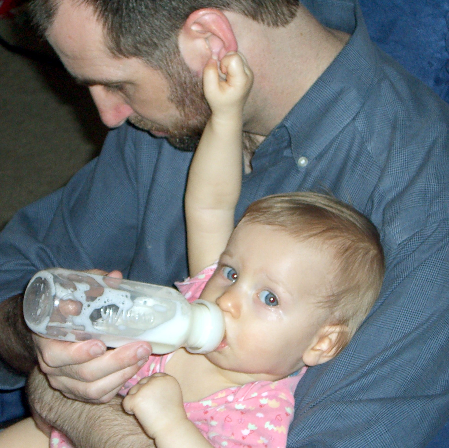 Bottle-feeding while holding an ear, March 2006
