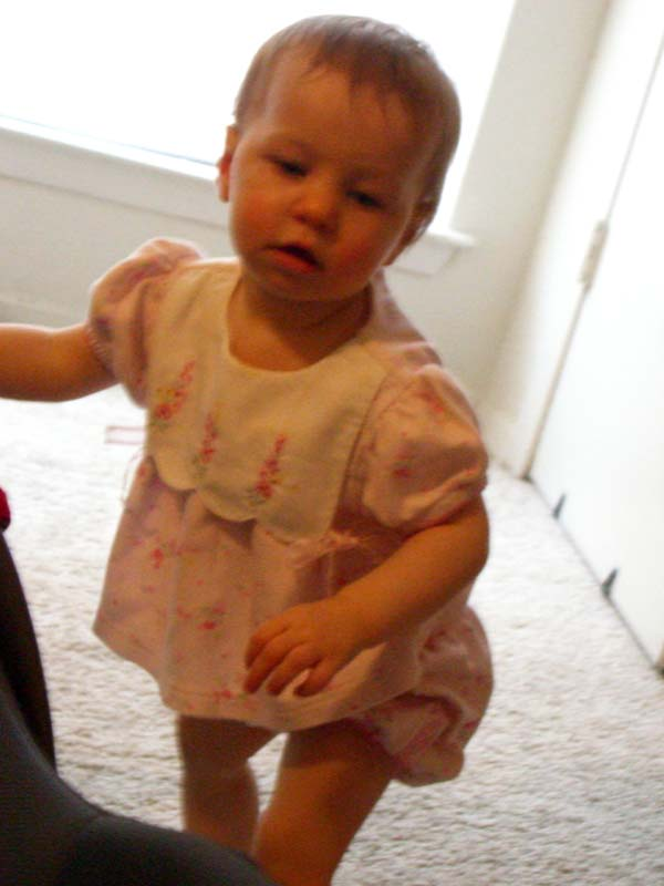 E almost standing unsupported at 11 months, April 2006