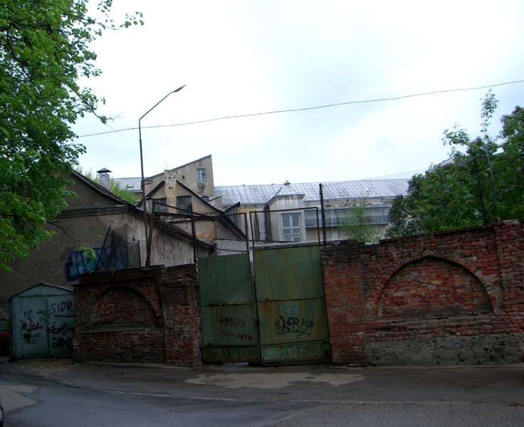 Red brick gate and graffiti