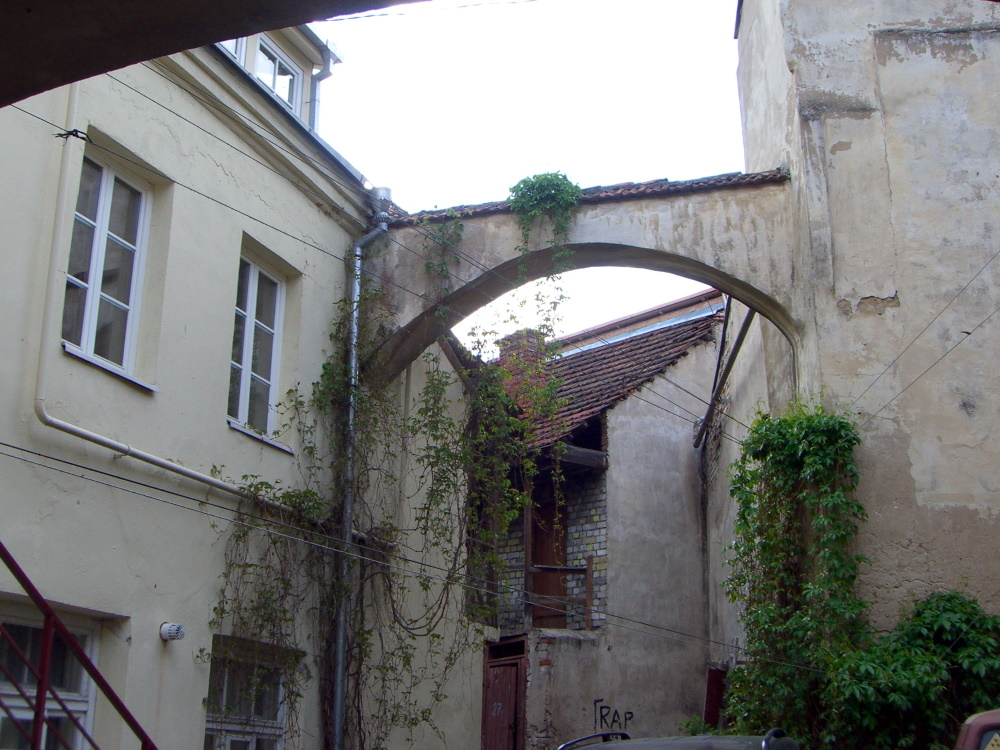 A red roof peeking behind an arch