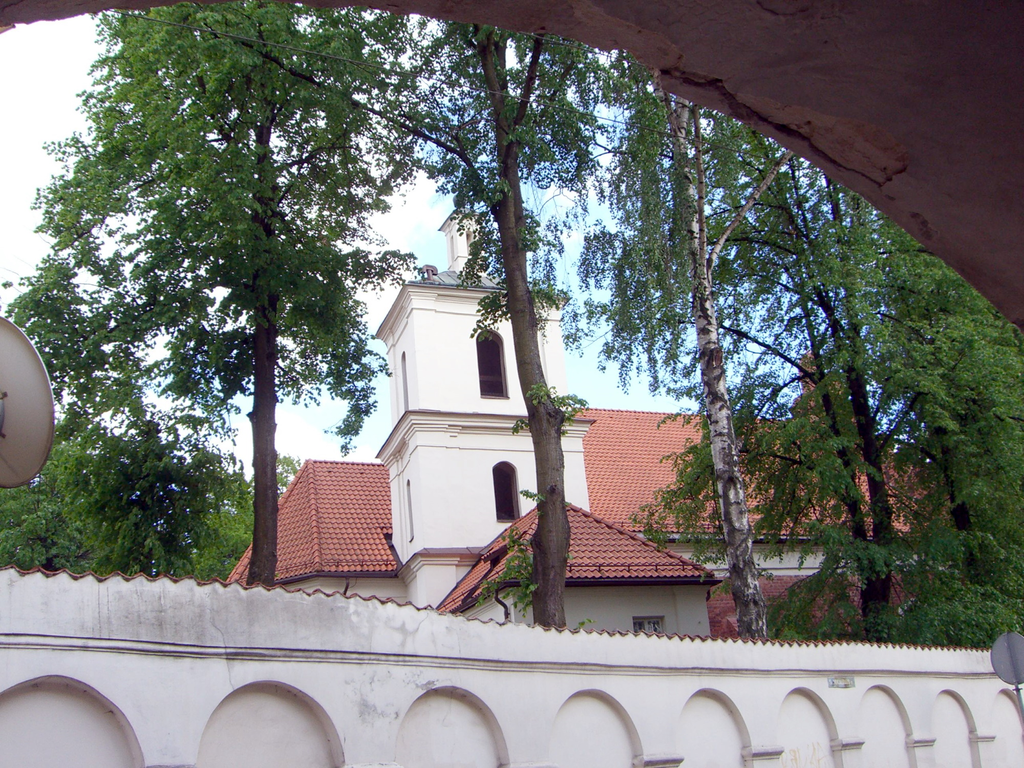 A church wall with arches in it