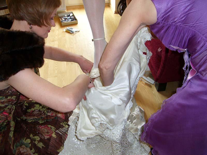 M steps into her wedding dress