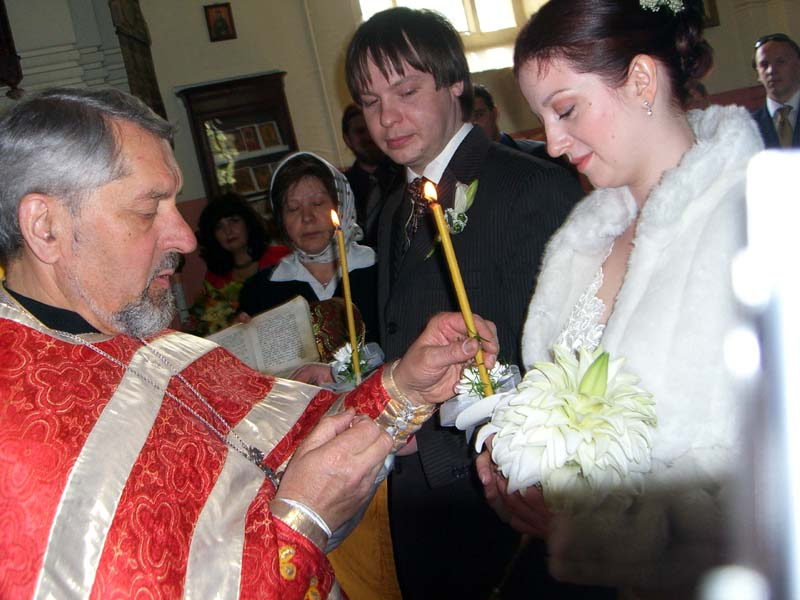 P, M, the priest and candles