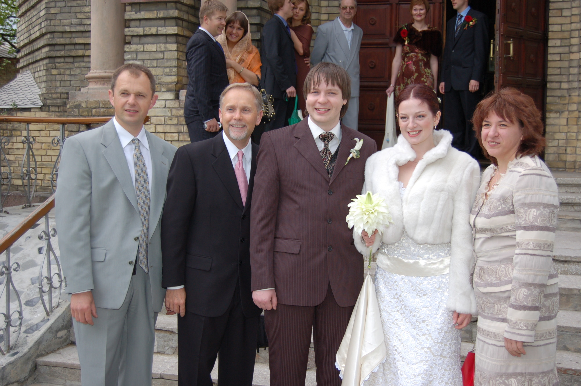 Kevin, P, M and others in front of the church