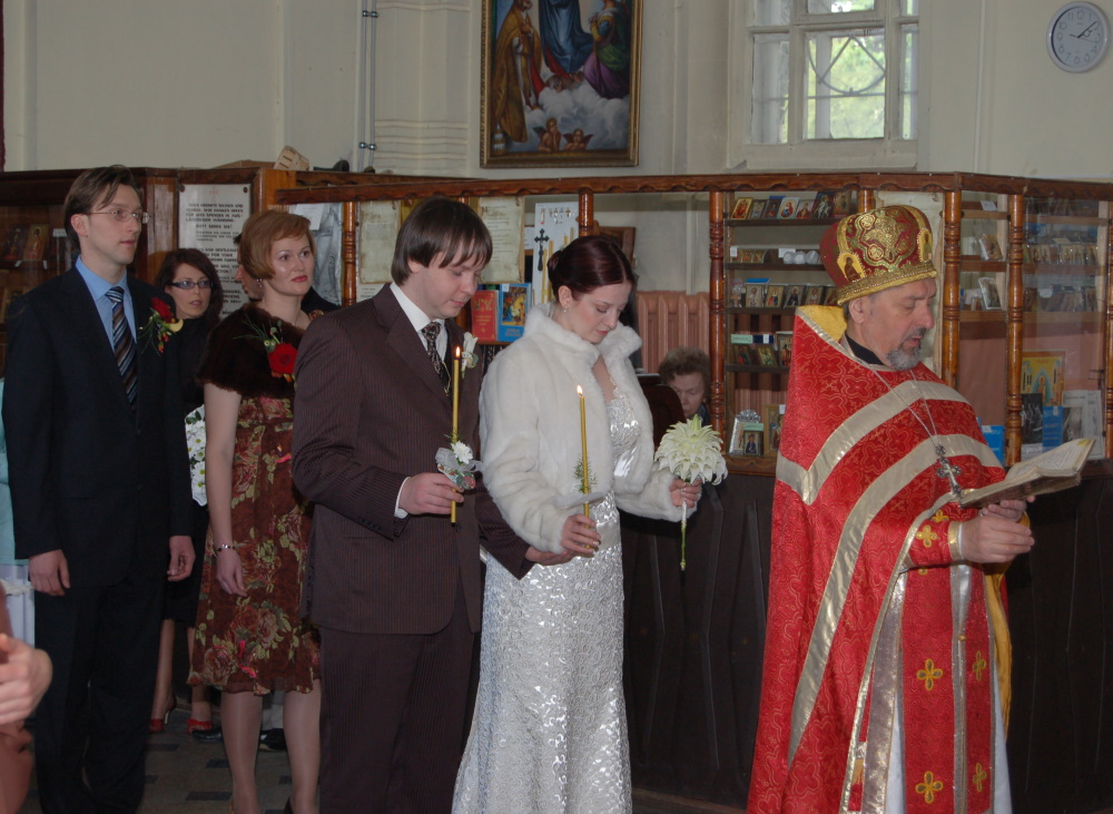 P, M and their witnesses are being lead by the priest