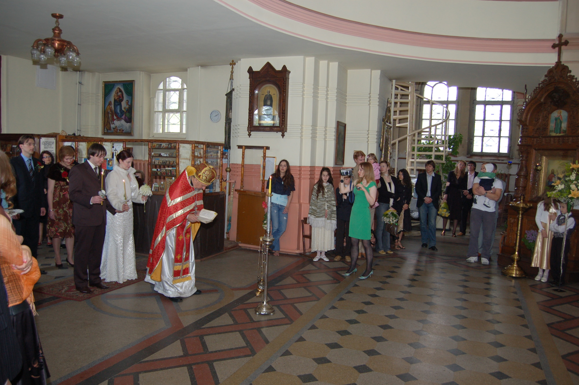 The priest bows before the altar