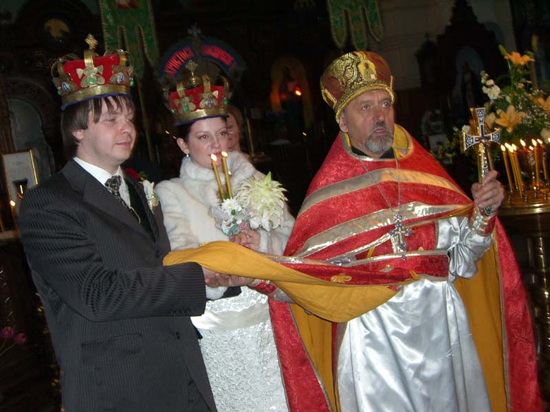 P and M walk, lead by the priest