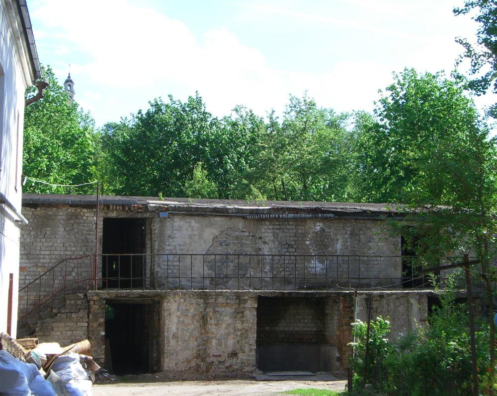 A decaying former garage / storage building