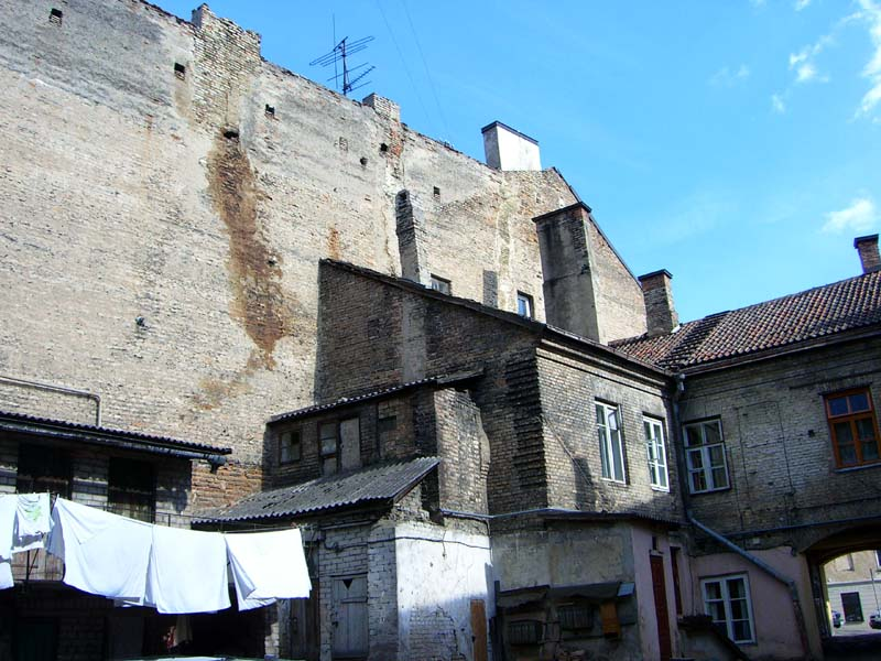 Another house with tiny windows along the roof in Uzupis