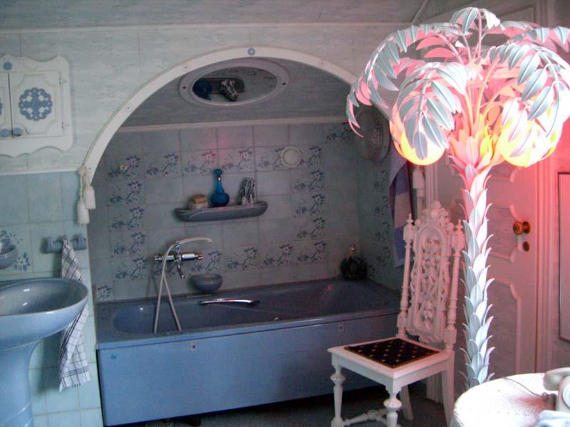 A bathroom with plastic palm tree
